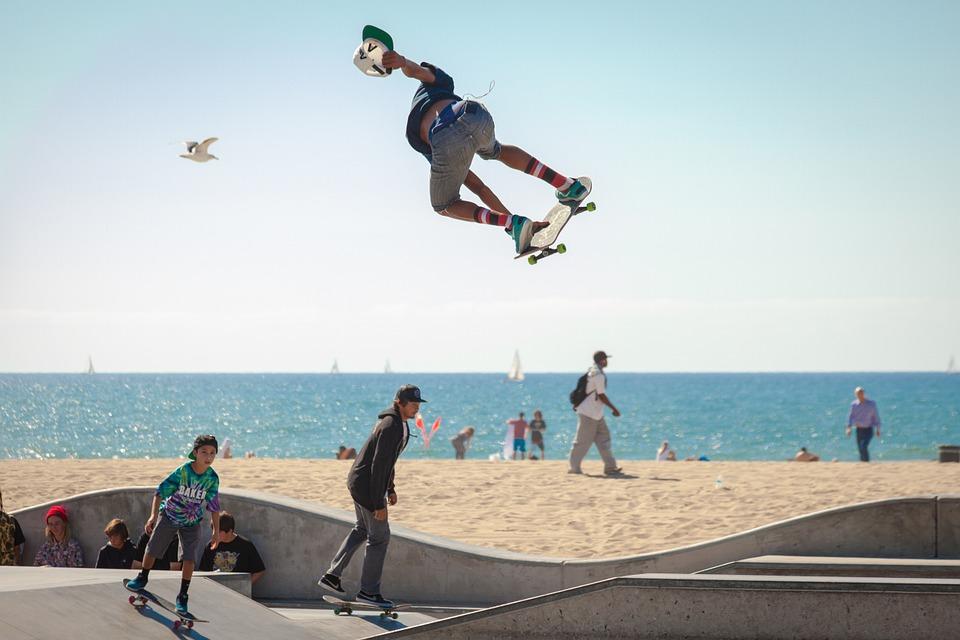 skate boaders near beach